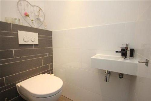 Betegeling badkamer en wc